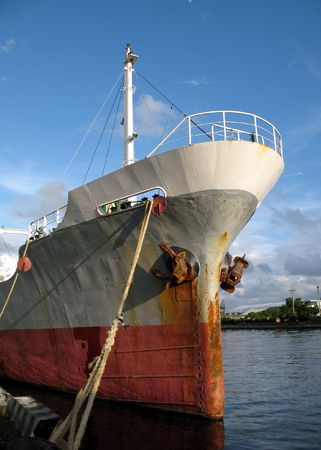 Old rusty freight carrying ship anchored in port Stock Photo - 4820892