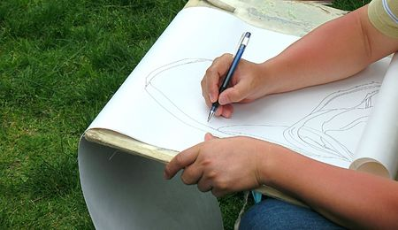 draftsman: A draftsman is drawing a nature scene with a pencil
