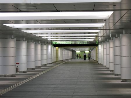 both sides: A connecting underground passage with massive columns on both sides Stock Photo