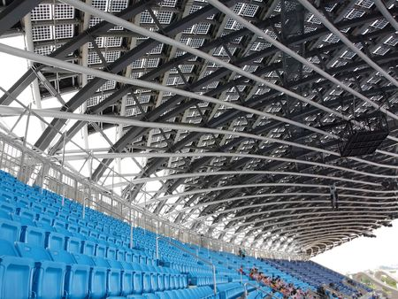 venue: Partial view of a large sports venue with few people Stock Photo