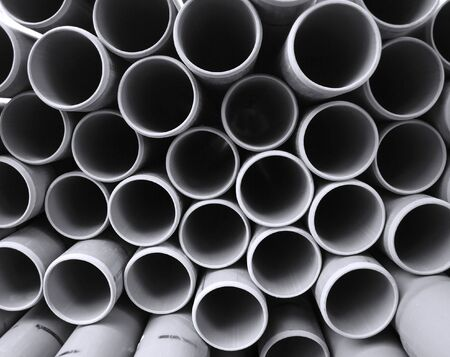 A stack of PVC pipes in preparation for a canalisation project photo