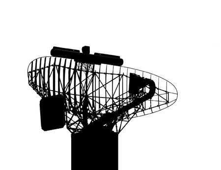 A silhouette of a military radar installation