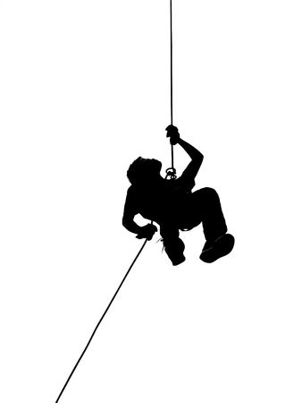 abseil: A male climber rappels downward on a rope