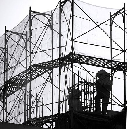 Steel pipes, ladders and safety nets are used as scaffolds  photo
