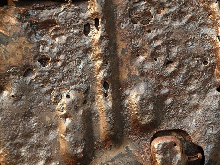 metal corrosion: A close view of a rusted piece of scrap metal