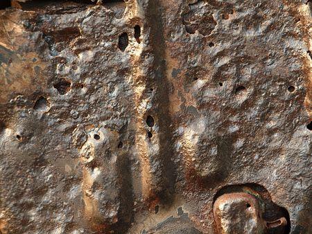 scrap iron: A close view of a rusted piece of scrap metal