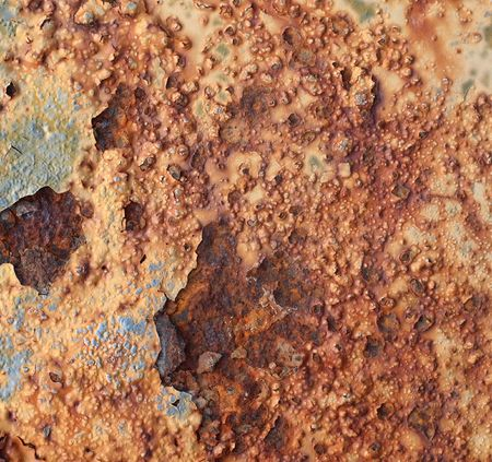 disintegrate: A close view of strong rust caused by salt corrosion
