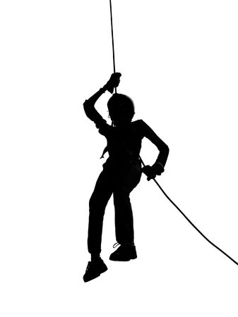 A climber rappels downward on a rope Stock Photo