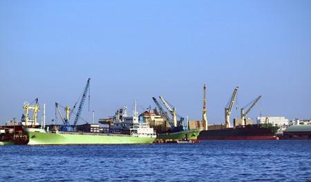Crane, cargo ships and warehouses at Kaohsiung harbor photo
