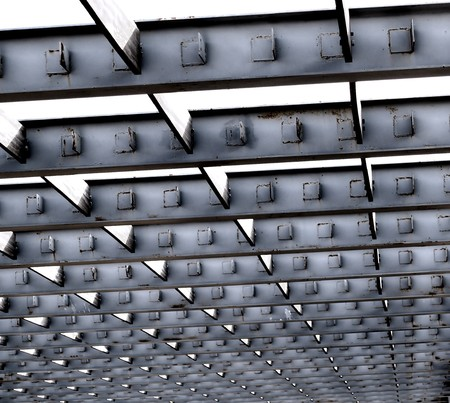 girders: Pattern of gray steel girders in preparation for roof construction   Stock Photo