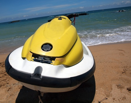 personal watercraft: A personal watercraft rests on a beach