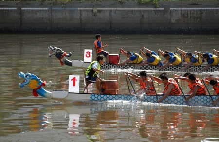 KAOHSIUNG, TAIWAN - JUNE 3: To celebrate the Duanwu Festival Kaohsiung City in Taiwan conducts international Dragon Boat races on the Love River on June 3, 2011 in Kaohsiung, Taiwan.