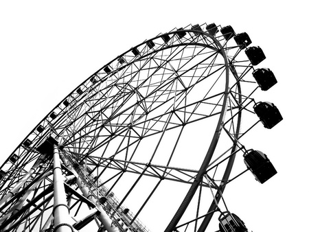 A ferris wheel at a local fun fair seen in silhouette Stock Photo