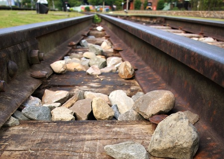 Two rusty steel railroad tracks are converging at a junction Stock Photo - 10411116