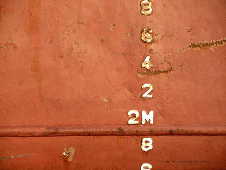 freighter: Closeup view of the waterline of a freighter ship anchored in port