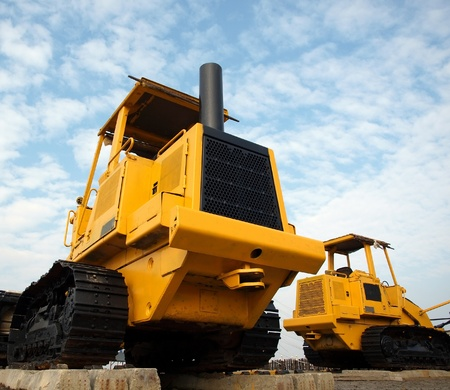 earth moving: Heavy earth moving machinery is resting on concrete sleepers