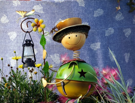 garden staff: A garden light made in the shape of a funny figure