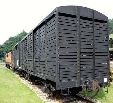A vintage railroad car on a narrow track photo