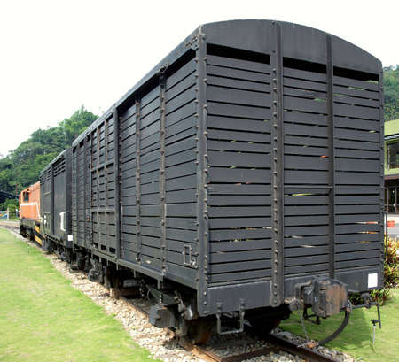 wood railroad: A vintage railroad car on a narrow track