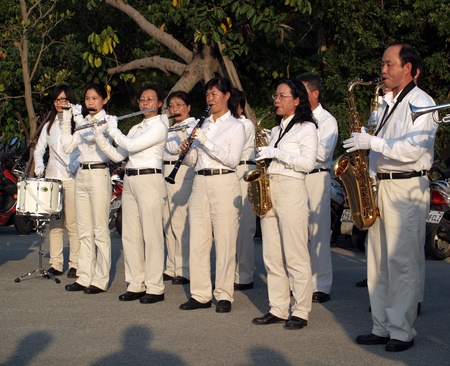 KAOHSIUNG, TAIWAN, JANUARY 26: An unidentified marching band plays for onlookers as part of the activities of the Kaohsiung 2012 Spring Art Festival on January 26, 2012 in Kaohsiung.