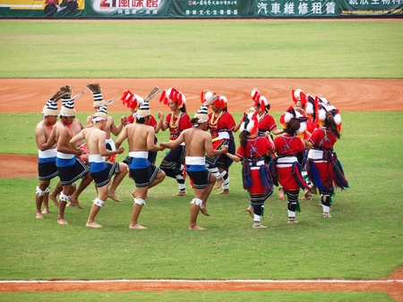 aborigines: PINGTUNG, TAIWAN, APRIL 8: Aboriginal dancers perform before a Pro Baseball League game between the President Lions and the Lamigo Monkeys. The Lions won 2:0 on April 8, 2012 in Pingtung.