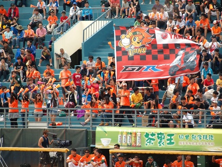 PINGTUNG, TAIWAN, APRIL 8: Fans are cheering for the President Lions in a Pro Baseball League game against the Lamigo Monkeys. The Lions won 2:0 on April 8, 2012 in Pingtung.  Stock Photo - 13154536