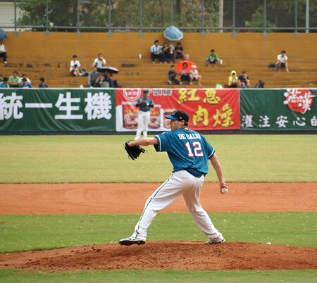 baseball pitcher: PINGTUNG, TAIWAN, APRIL 8: Pitcher De Salvo of the Lamigo Monkeys in action in a game of the Pro Baseball League against the President Lions. The Lions won 2:0 on April 8, 2012 in Pingtung.