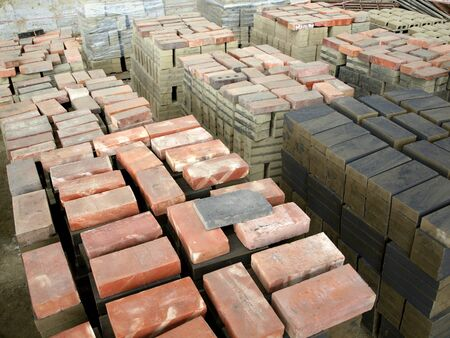 brick kiln: Stacks of freshly molded bricks are drying before firing Stock Photo
