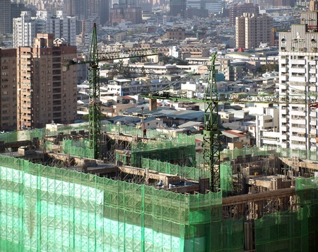 overpopulation: Construction site with two cranes seen from above
