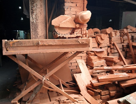 Roof tiles and other bricks are scattered in an old kiln Stock Photo - 13335647