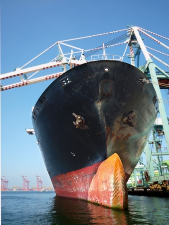 massive: A massive cargo ship at Kaohsiung port with a bulbous bow