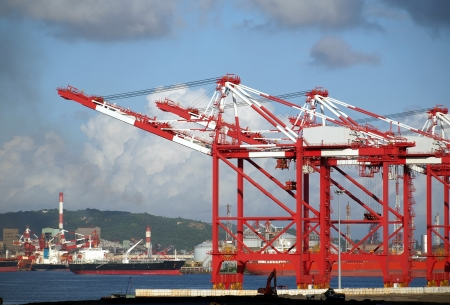 Part of Kaohsiung port with gantry cranes and industrial ships Stock Photo - 14828404