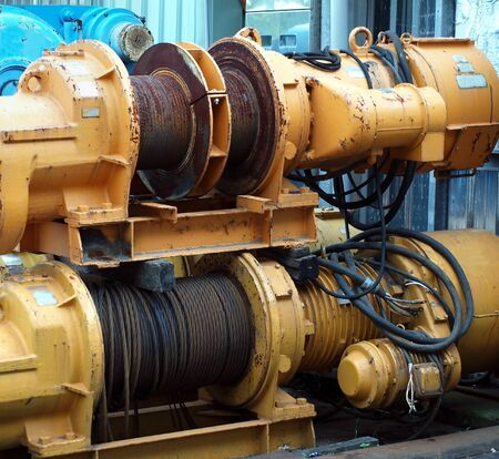 haul: Large industrial winches are used to haul in steel cables