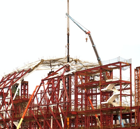 girders: A major construction project with steel girders and multiple cranes