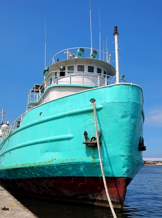 A vintage Chinese fishing boat is anchored in port on a beautiful summer day Stock Photo - 20331686