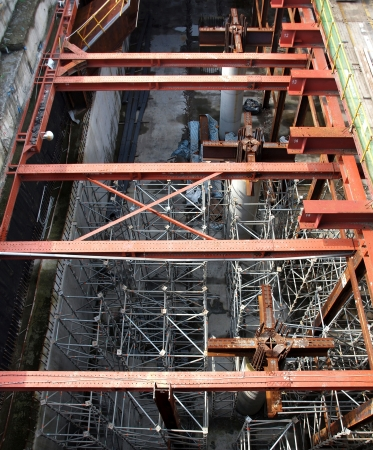 girders: A large underground construction site with strong pillars and girders