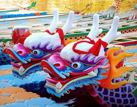 KAOHSIUNG, TAIWAN - JUNE 11: Decorated dragon boats on the Love River in Kaohsiung are ready for the Dragon Boat Festival on June 11, 2013 in Kaohsiung
