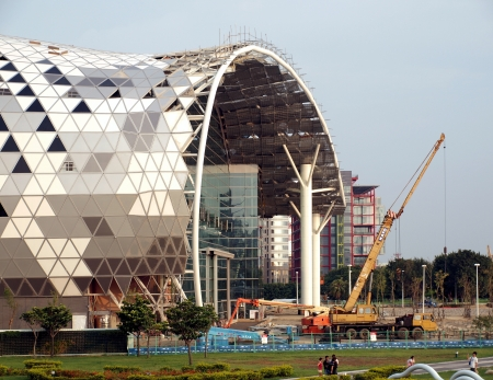 KAOHSIUNG, TAIWAN - JUNE 30: Construction continues on the new Kaohsiung Exhibition and Convention Center, scheduled to open in early 2014, on June 30, 2013 in Kaohsiung