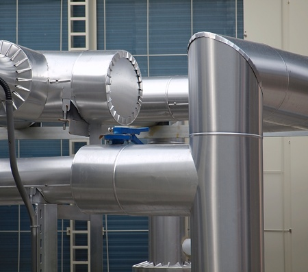 Large stainless steel pipes of an industrial air cooling system Stock Photo