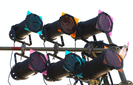 metal pole: Multi-colored spotlights are mounted on metal poles   Stock Photo
