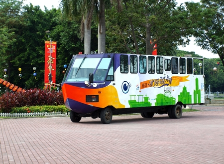amphibious: KAOHSIUNG, TAIWAN -- OCTOBER 13: A special amphibious city bus transports visitors to the yearly Wannian Folklore Festival on October 13, 2013 in Kaohsiung.