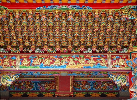 richly: Chinese temple detail with a richly carved ceiling and reliefs
