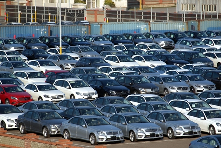 constitute: TAICHUNG, TAIWAN -- JANUARY 1, 2014: Luxury car shipments constitute a large part of the business of Taichung Port. Pictured here are newly imported Mercedez Benz sedans.
