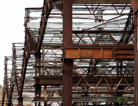girders: Rusting beams and girders of a deserted factory building   Stock Photo