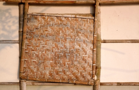 mud wall: A traditional Chinese farmhouse made from bamboo with a bamboo window cover Stock Photo