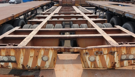 flatbed truck: Long container trailer chassis used for transporting shipping containers