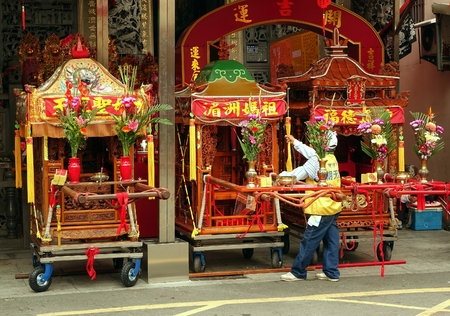palanquin: KAOHSIUNG, TAIWAN -- APRIL 19, 2014: Three sedan chairs which contain religious objects are being prepared for a ceremony in honor of the goddess Matsu.