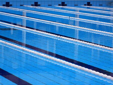 floats: Swimming pool with lanes marked by ropes and floats