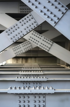 girders: The underside of a bridge with large steel girders, bolts and nuts Stock Photo