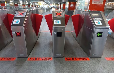 ticketing: KAOHSIUNG, TAIWAN -- JULY 8, 2014: Automatic ticket reading machines at the Kaohsiung subway system Editorial